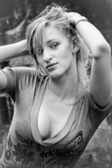 black and white portrait of blonde woman with sexy breast