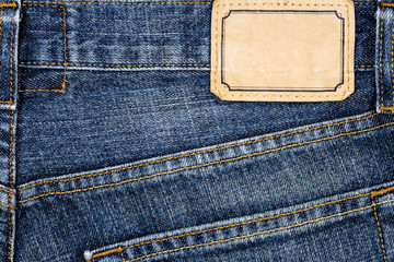 Label sewed on a blue jeans
