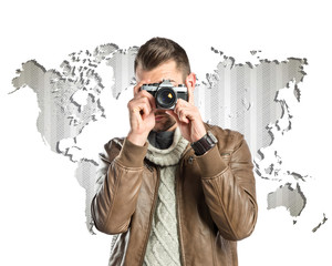Man photographing over map background