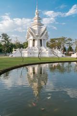 white temple  Wat Rong Khun with reflection,  Chiang Rai