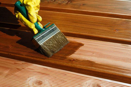 Painting Douglas fir timber piling for a patio