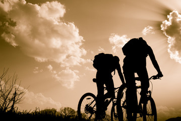 silhouettes of cyclists