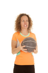 woman orange sports shirt hold medicine ball