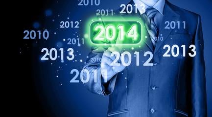 Businessman touching new year 2014