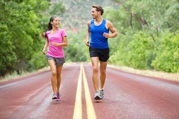 Running - exercising couple jogging