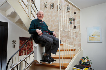 grandfather using the stairlift Fototapete