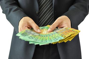 Businessman hands holding money  - Australian dollars
