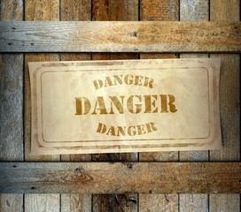 Stamp Danger label old wooden box