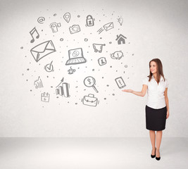 Young business woman presenting hand drawn media icons