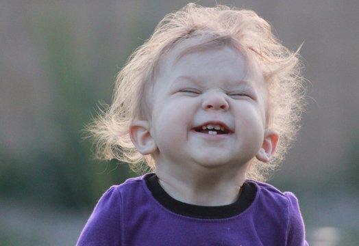 Little baby girl smiling laughing having fun