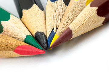 several colorful pencils placed on white background