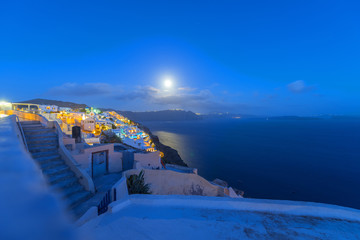 Fototapete - Greece Santorini island in cyclades night view with moon