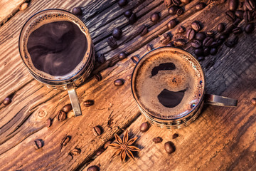 Wall Mural - Closeup of hot coffee in old wooden table