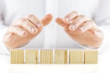 Six blank wooden cubes
