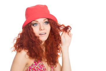 Beautiful thoughtful girl in red panama hat
