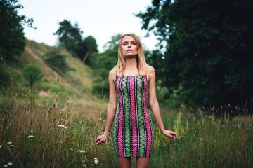 Model girl on the Field in Sun Light. Long Hair