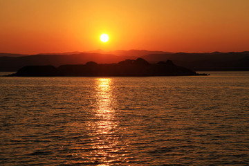 Sunset over a greek island in the Mediterranean sea