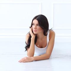 Beautiful brunette on the floor