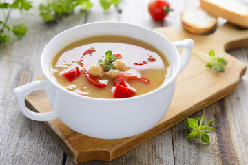 Hot vegetarian soup from chickpeas and lentil