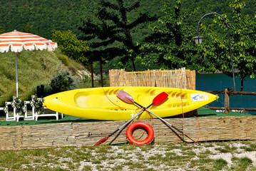 Yellow bright canoe on lake of Italy