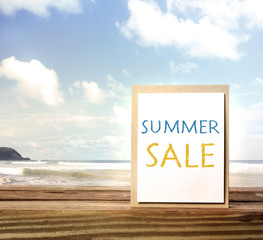 Summer sale sign over ocean and sky