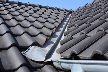 The roof is covered with black burnt roofing