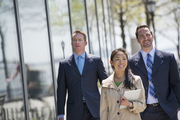 A Businesswoman And Two Businessmen Outdoors In The City.