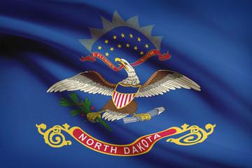 Series of ruffled flags of US states. State of North Dakota.