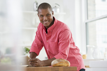 A Young Man In A Pink Shirt Using A Digital Tablet.
