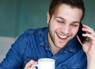Man smiling with mobile phone