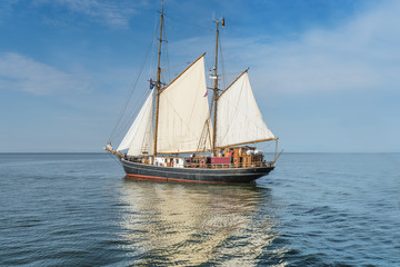 Tall ship on blue water horizontal