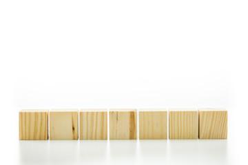 Seven blank wooden blocks