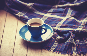 blue cup of the coffee and vintage scarf.