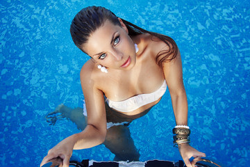 beautiful young woman with blue eyes in the pool