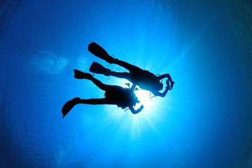 Couple Scuba Diving silhouette