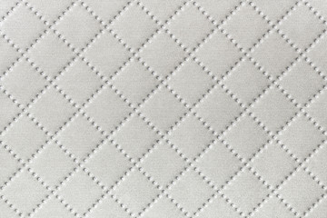 Background of white textile texture with diamond pattern