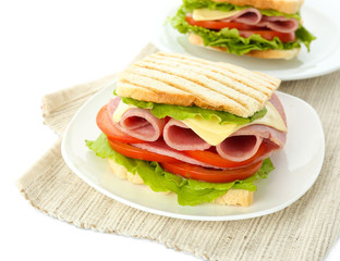 Tasty sandwiches with ham, isolated on white