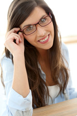 Portrait of beautiful business girl with eyeglasses on