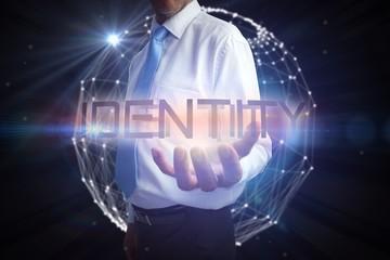 Businessman presenting the word identity