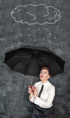 Business woman sheltering herself from the rain