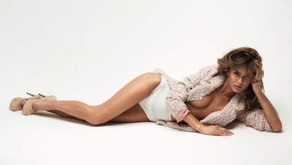 Sexy woman lying on white background without bra