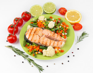 Tasty grilled salmon with vegetables, isolated on white