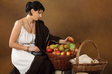 Young Romana with basket full of fruits and vegetables.