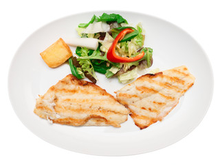Grilled seabass fillet in plate, isolated