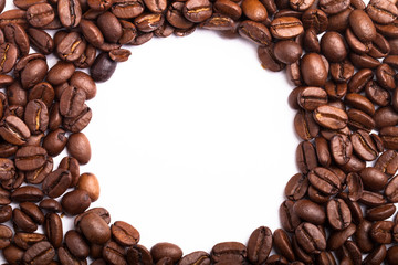 Circle frame of roasted coffee beans isolated on white