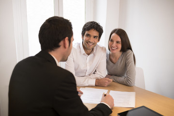 Young Couple meeting real-estate agent to buy property