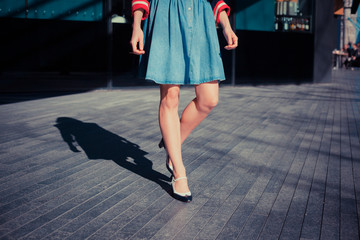 Young woman walking on the street
