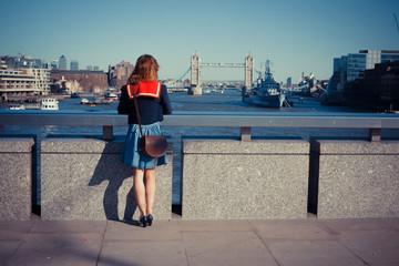 Young woman admiring London skyline