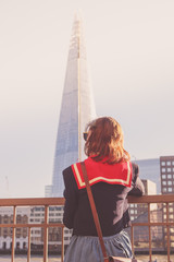 Young woman admiring the Shard in London