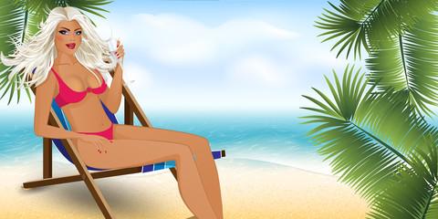 beautiful girl in a sun lounger on the beach